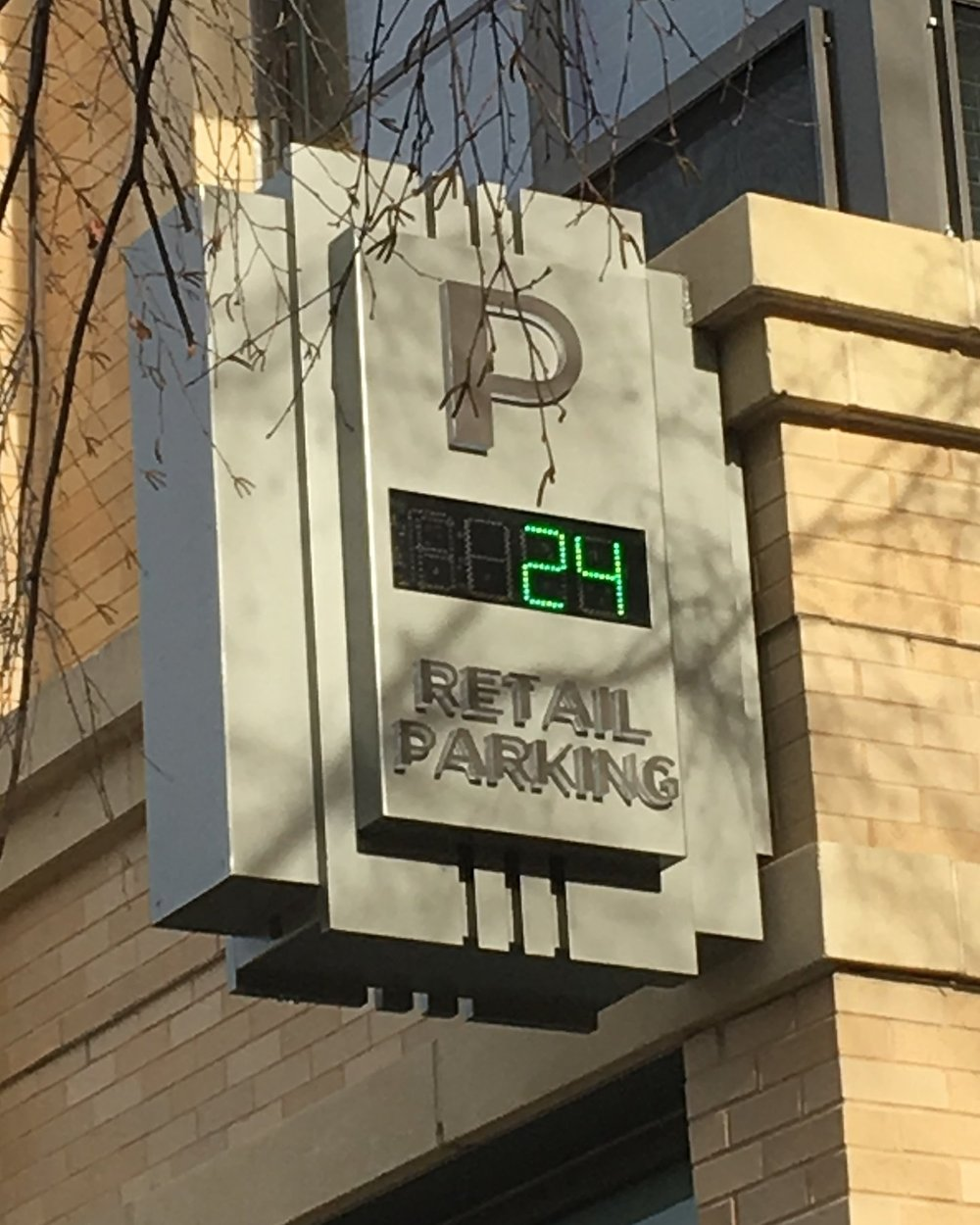If you're driving to us, look for this parking garage sign!