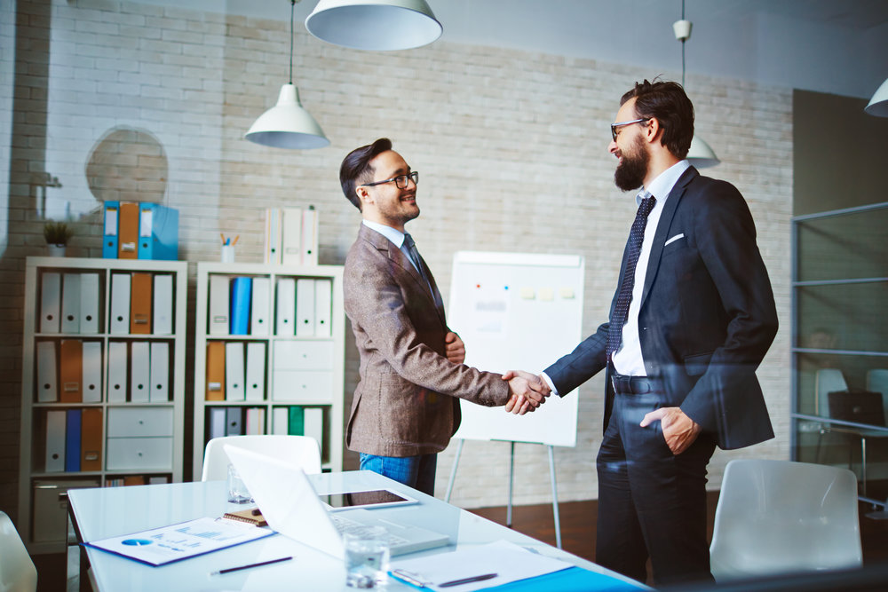 stock-photo-business-team-meeting-handshake-applaud-concept-370921607.jpg