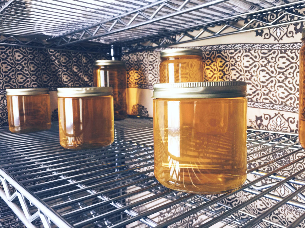 Hot ghee, cooling on a shelf