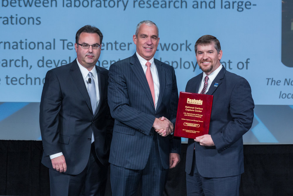 (L-R) Power-Gen International Chairman Russell Ray and Peabody Group Chief Marketing Officer Bryan Galli presented the Carbon Capture and Storage Pioneer award to National Carbon Capture Center Director John Northington during the opening session of Power-Gen on Dec. 5.
