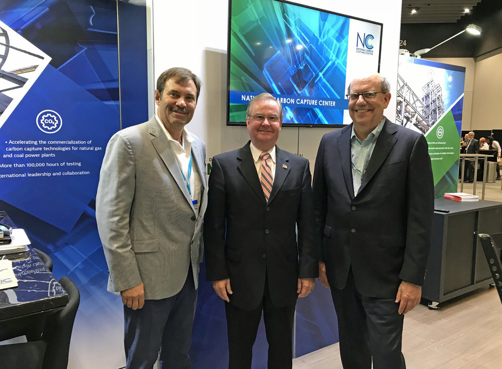 After delivering his keynote, U.S. Department of Energy (DOE) Assistant Secretary for Fossil Energy Steve Winberg (center) joined Southern Company's Richard Esposito, left, and Frank Morton, right, at the National Carbon Capture Center exhibit.