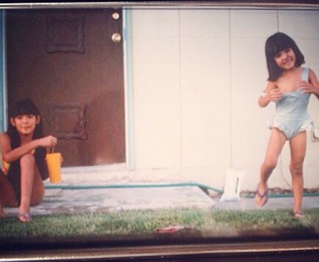 4 years old, playing with my sister, Charity, at our home in North Las Vegas