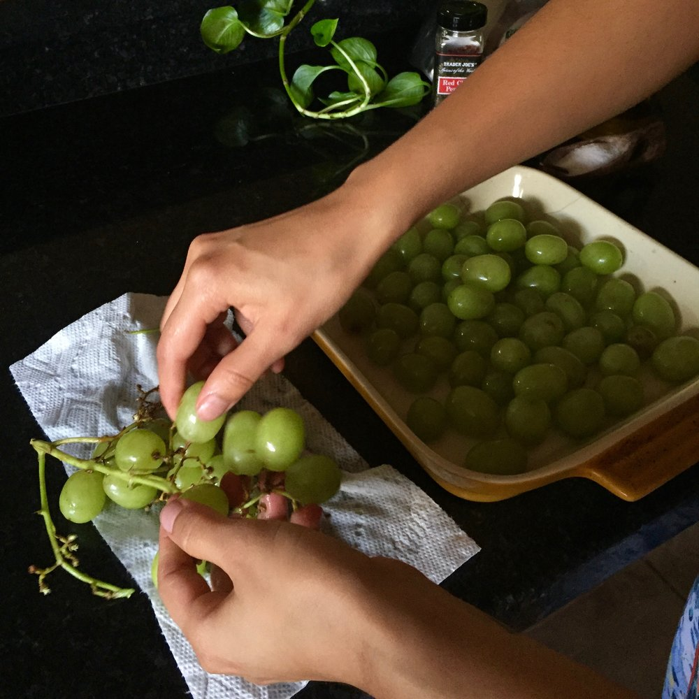 "Rinse and pluck grapes, tossing into a 9x9"" oven safe baking dish"