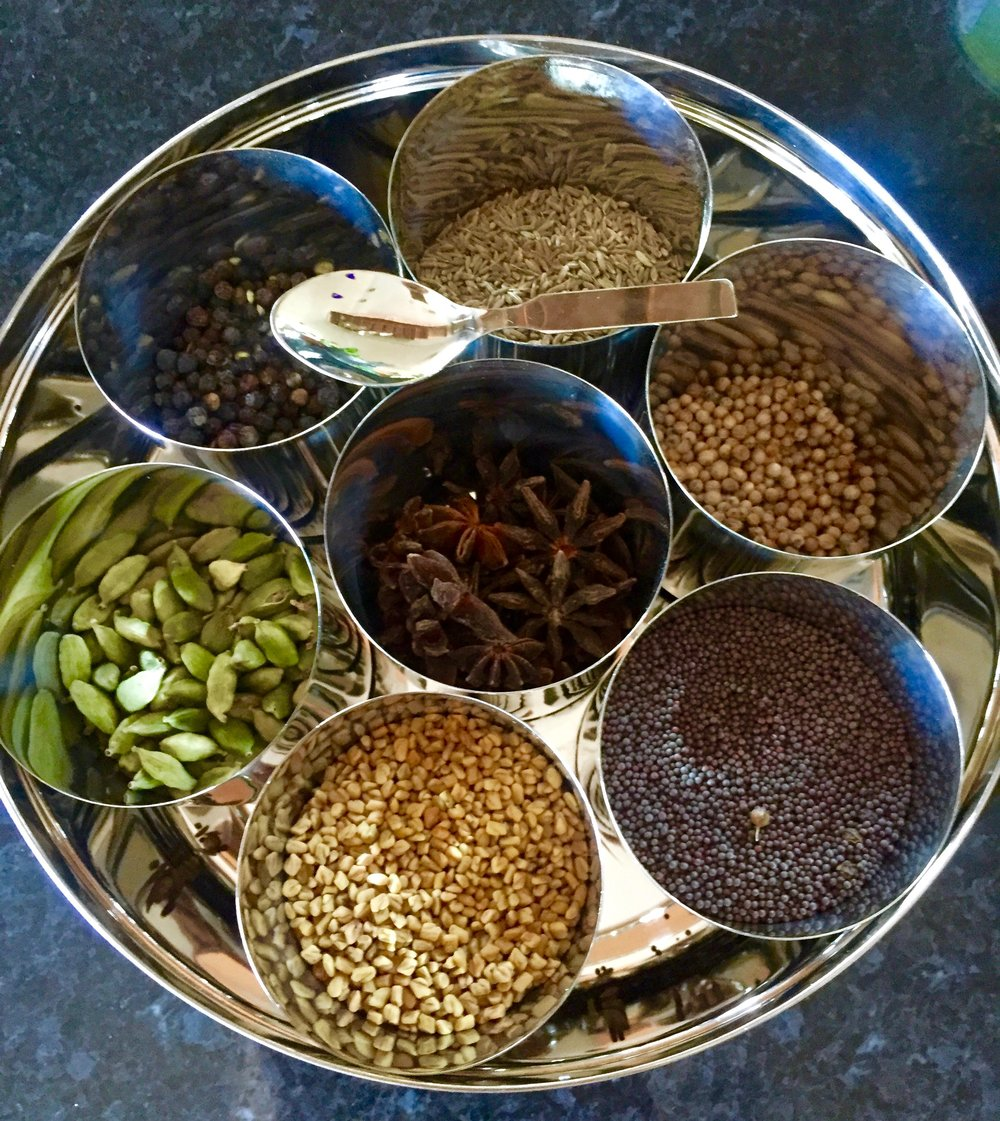 My spice dabba holds all of my indian spices. Today I only used the cumin and coriander.