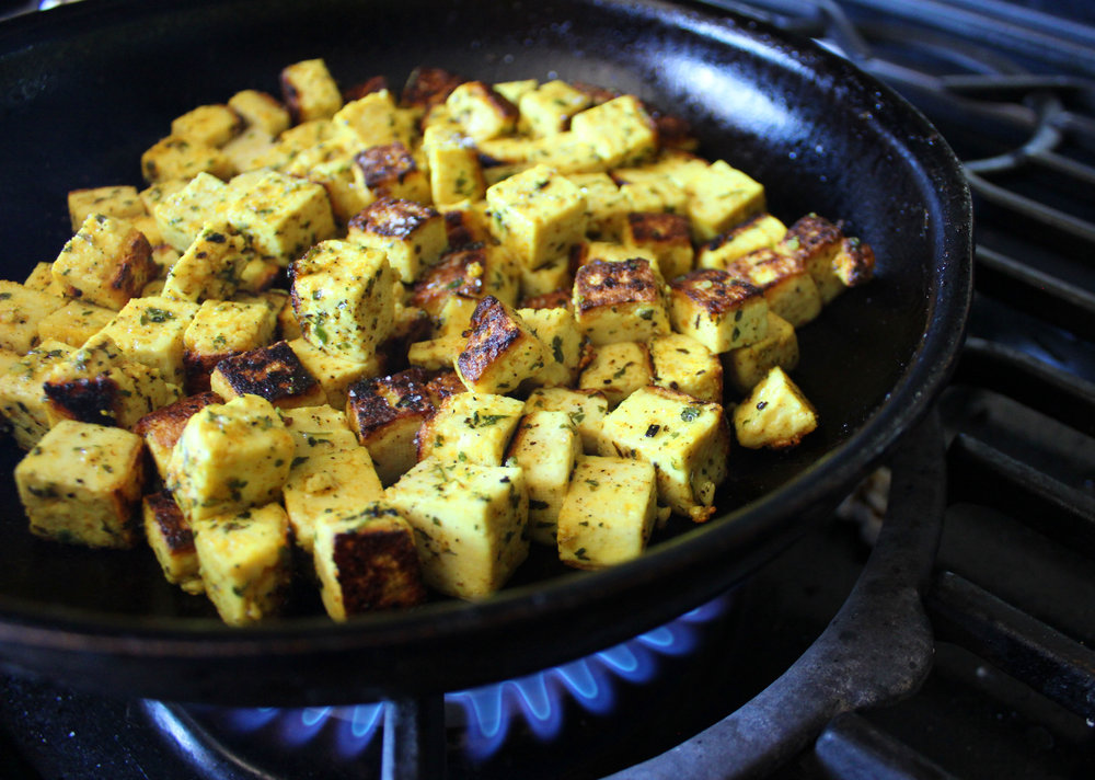 Toss the tofu in. Allow to sit (don't move!!) for 6-7 minutes before tossing the tofu to cook second sides. Repeat as you like until its crispy on most sides!