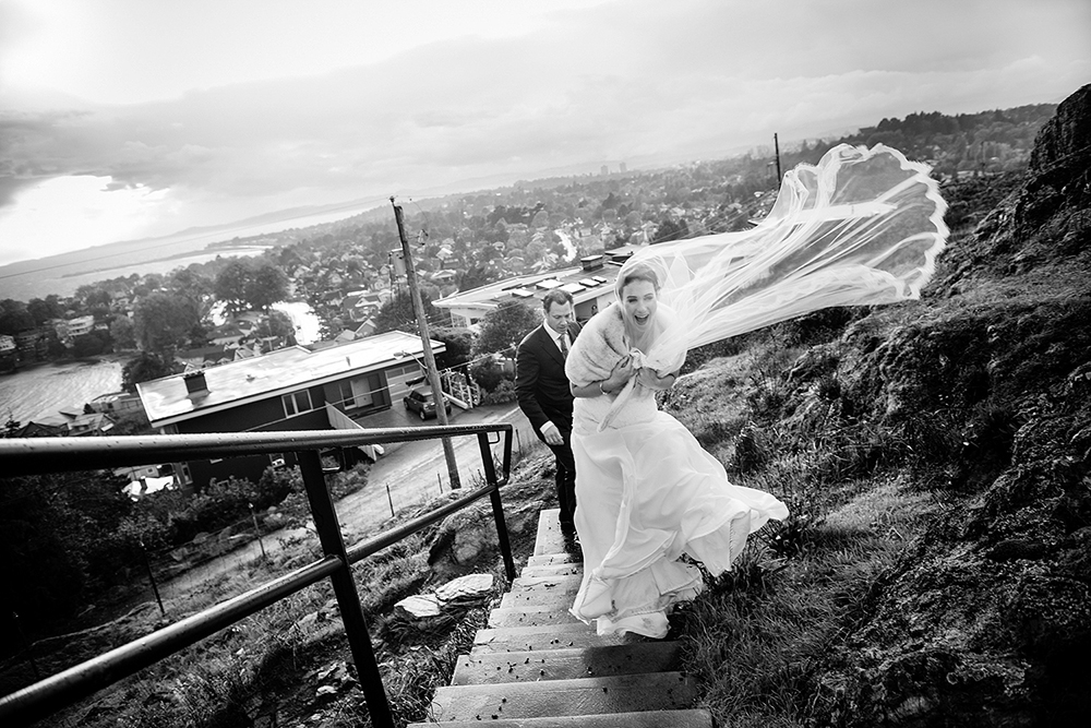 wedding couple laughing during a windy storm, victoria bc