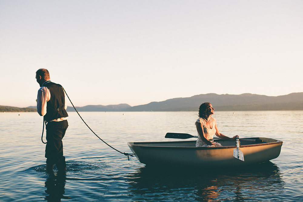 groom pulling boat with bride in it, Vancouver Island BC