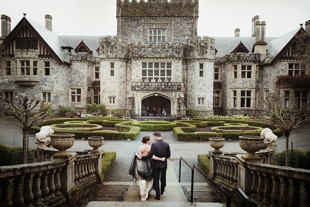 wedding couple embraces walking towards Hatley Castle