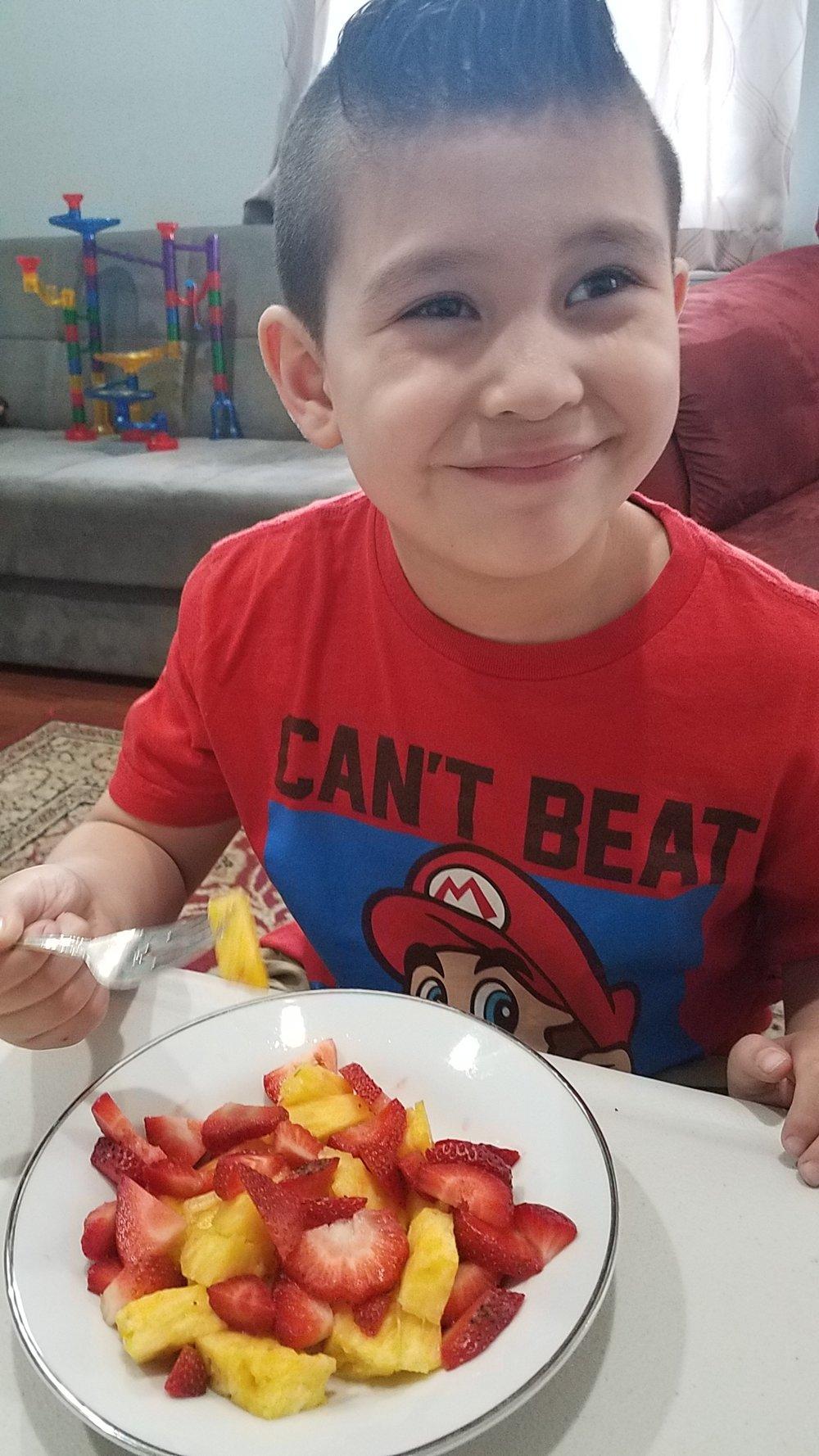 Julio loving fruit!