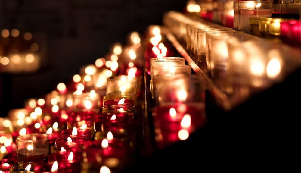 rows_of_candles_church.jpg