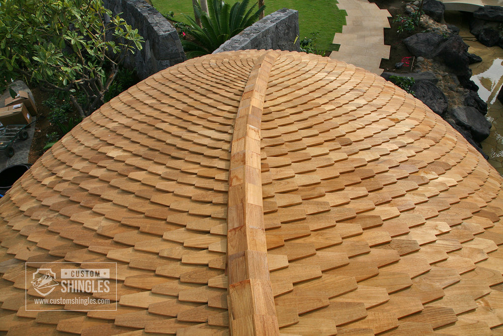 curved teak shingle roof