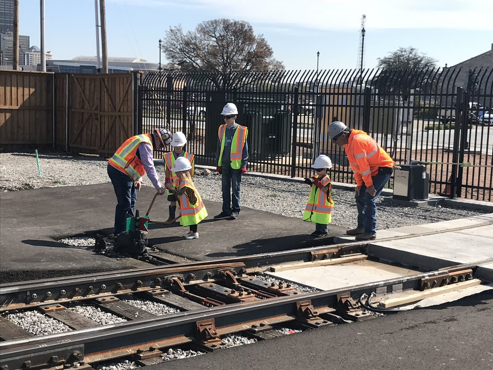 Future railroaders operate a track switch in the OKC Streetcar's maintenance facility.