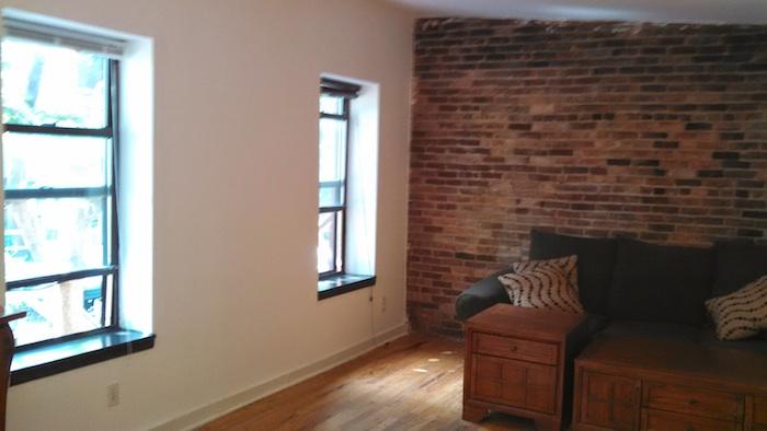 124#3 Living Room Brick.jpg