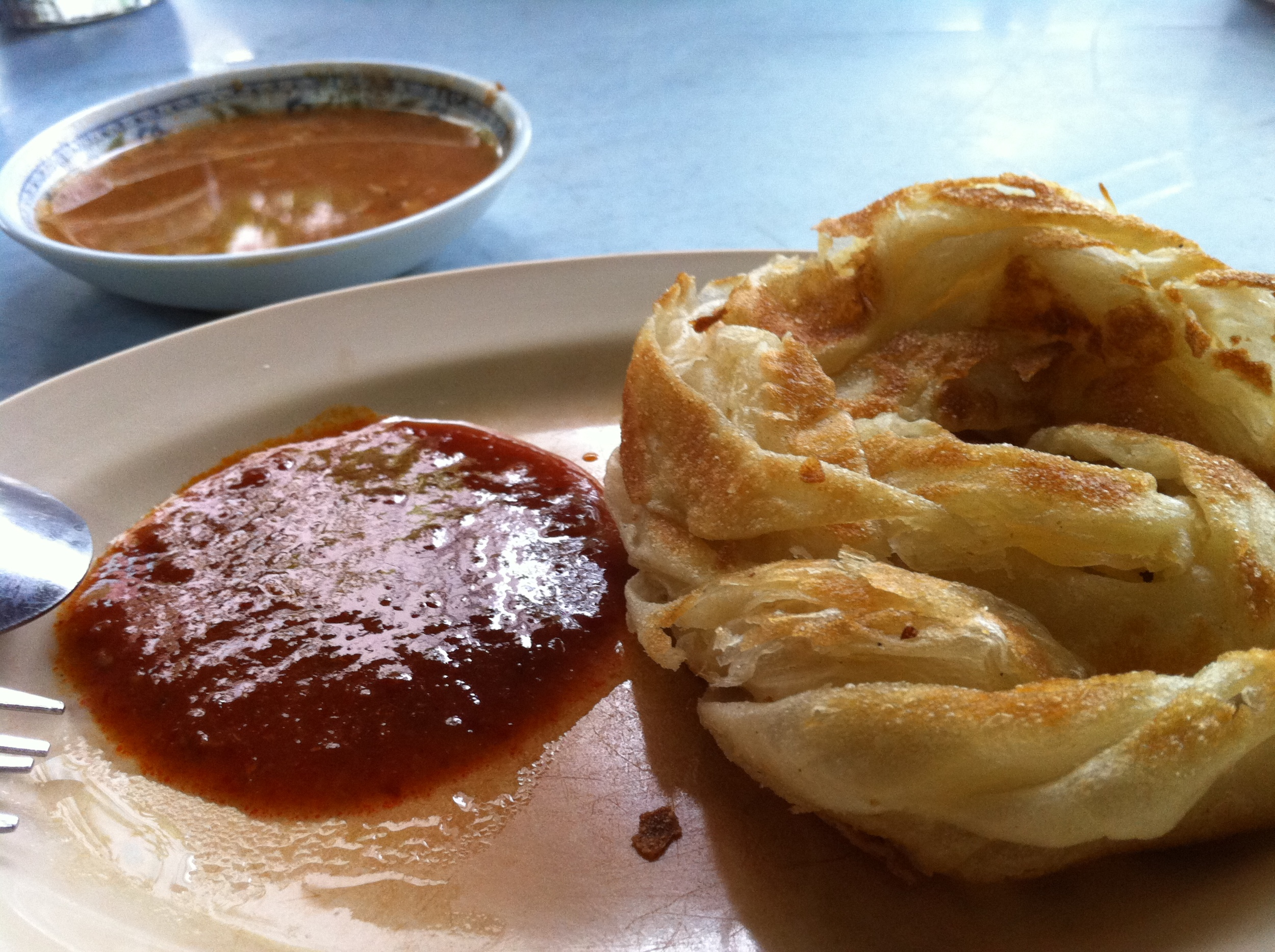 Roti canai (fried bread/pancake): Roti Canai Bukit Chagar: Junction of Jalan Bukit Chagar and Jalan Ungku Aziz (next to Pine View Apartments and PDRM Apartments)