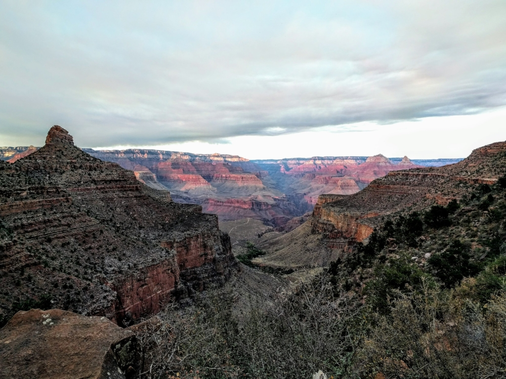 The Grand Canyon at sunset - its colors an enigmatic red, blue, purple and orange.