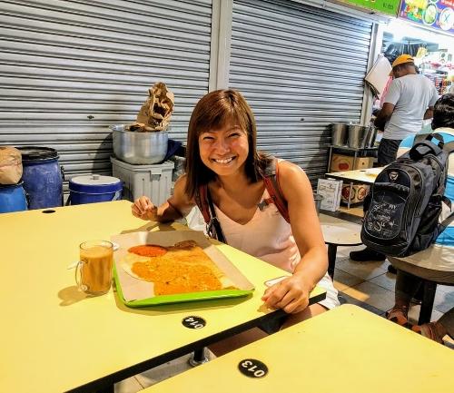 Enjoying my thosai and teh tarik halia (ginger milk tea) in Tekka food center