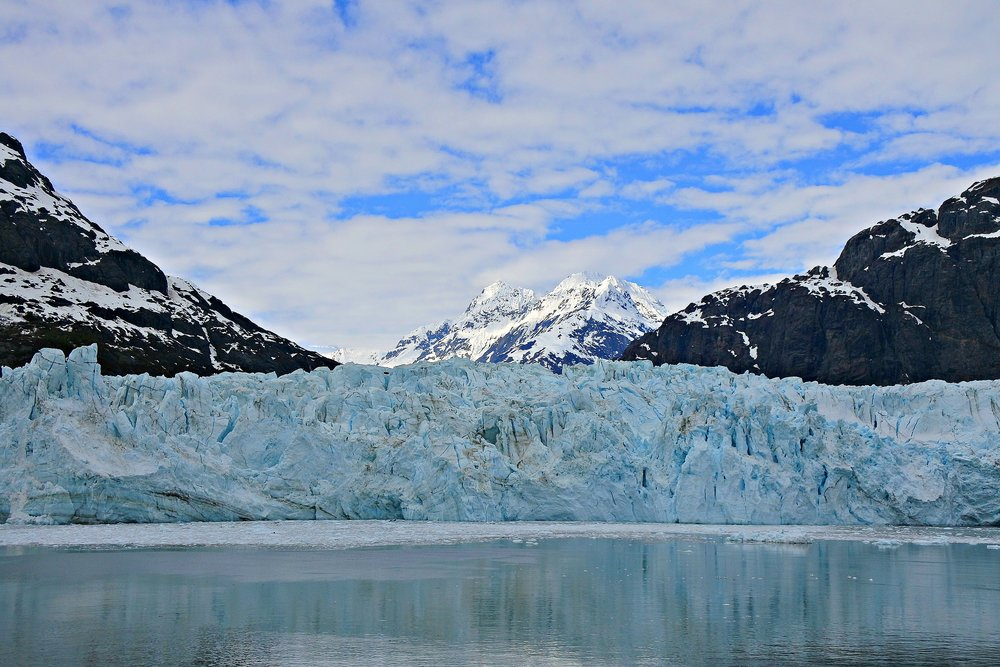 Glacier Bay, Alaska. Glaciers look blue because white light, when dispersed, has red, long wavelengths absorbed by ice while blue, short wavelengths are transmitted and scattered throughout the ice
