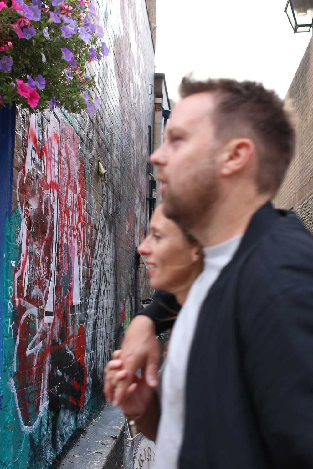 A blurred couple walking in Brighton, England. September 2018.   Picture rights: Angeline Tan