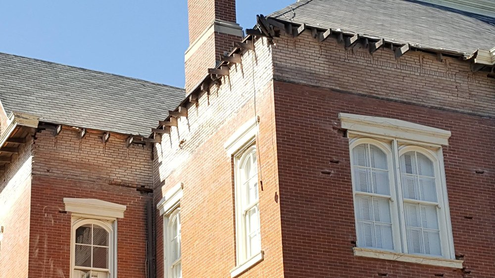 North façade cutting out selected bricks and grinding joints 2-min.jpg