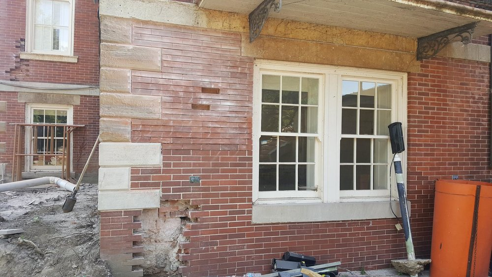 North façade cutting out selected bricks and grinding joints-min.jpg