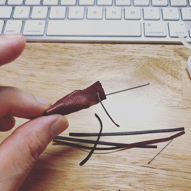 Lacing finger loops for sixth scale samurai arm guards. . . . #handmade #leatherwork #leathercraft #costumedesign #handdyed #onesixth #onesixthscale #actionfigure #custommade #handmade #handmadecrafts #handcraft #craftsmanship