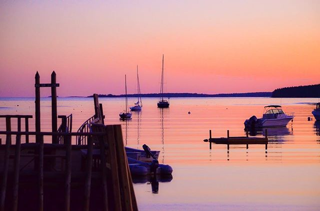 "Monday's aren't so bad when they end with views like this! Book a stay at our cottage ""The Defiance"" and enjoy dinner, cocktail hour, s'mores, or a late night game of cards with these never ending panoramic views! #floodscove #oceansunset #maine #summervacation"