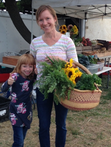 Longtime CSA members and market customers, Erica LaFrenier and her spunky daughter, Josie.