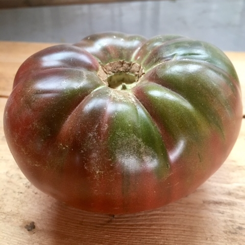Marnero - This French Heirloom is the t-bone steak of tomato varieties. Marnero's texture is dense, juicy, and beefy. Purple tomatoes are lower in acid than other tomatoes and Marnero's is savory, sometimes even smoky.