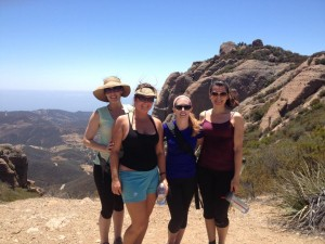 """This is a photo of four of us who met through GirlFriendCirlces who joined a group of others to hike in Malibu together, followed by lunch at Neptune's Net. The hike was really challenging--I think it was about 7 miles--but we pushed through and finished!"""