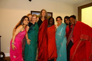 women playing dress up in saris