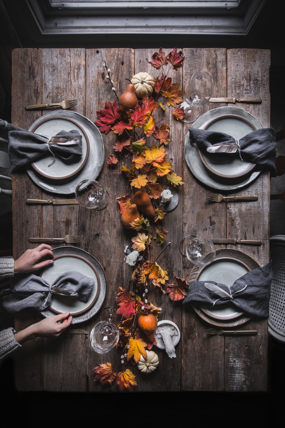 Mismatch is okay - Don't sweat it if your plates don't match or you don't have the same glass for every single place setting. There is beauty in an eclectic table. This thanksgiving table was created with four different dinner plates that didn't match the salad plates and three different styles of linen napkins. If you coordinate your pieces in similar tones or textures, they don't have to be exactly the same. This can add a ton of interest and make your table one of a kind.