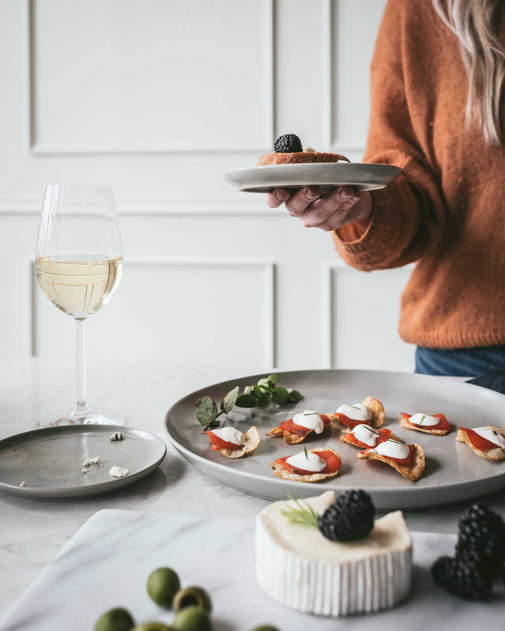 Salmon Crisps - 1 Package thick cut kettle style salted potato chips8 oz thinly sliced salmon lox4 oz creme fraicheFresh dill for garnishDirections: For each bite, layer potato chip, then salmon, then dollop of creme fraiche, then top with small sprig of fresh dill.Serve With: A Pinot Noir, we love a Pinot from the Willamette Valley, OR or a French Burgundy