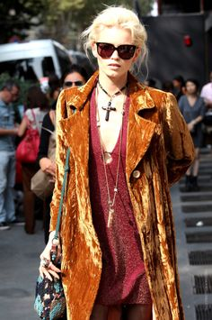 an amazing example of rockstar/alternative chic manifested in this woman's trench in orange crushed velvet