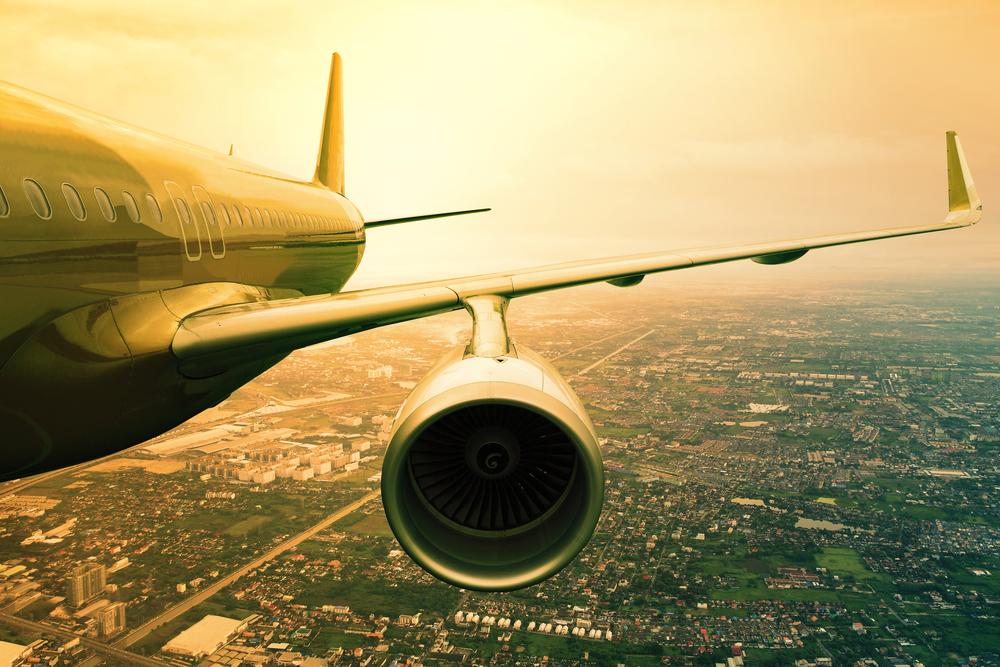 bigstock-Passenger-Jet-Plane-Flyin-Abov-80410787.jpg