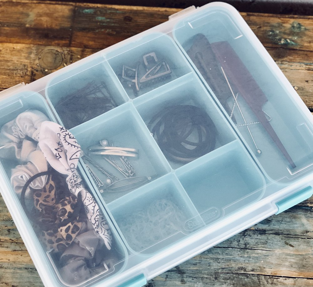 Sterilite- Divider - Store your hair clips, hair ties, bobby pins and combs in this super organized divided container. Place it under your bathroom sink for easy access when styling your hair.