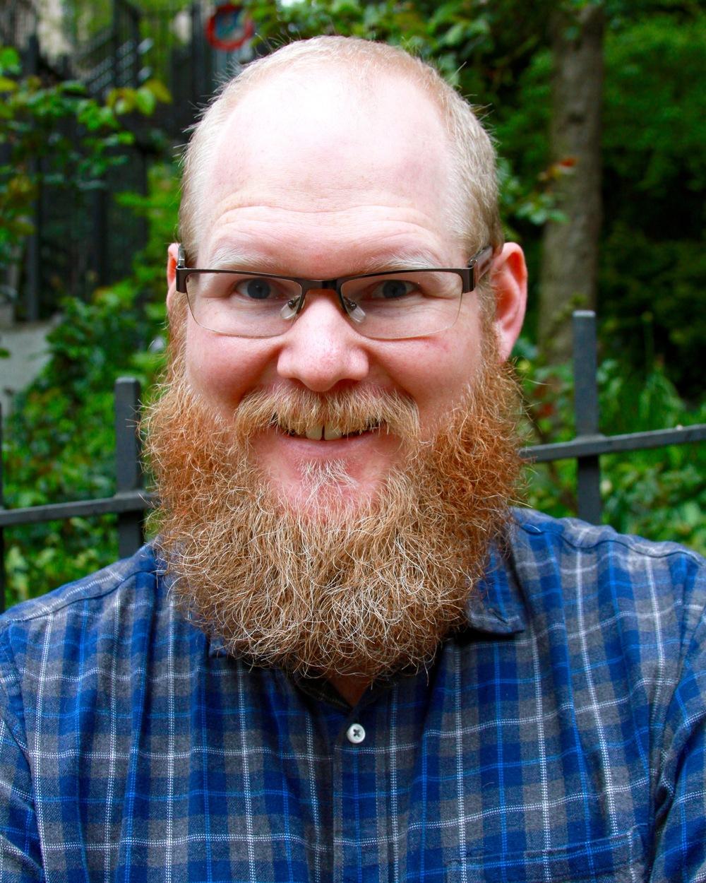 Tim Dufrisne glasses and long beard.jpg