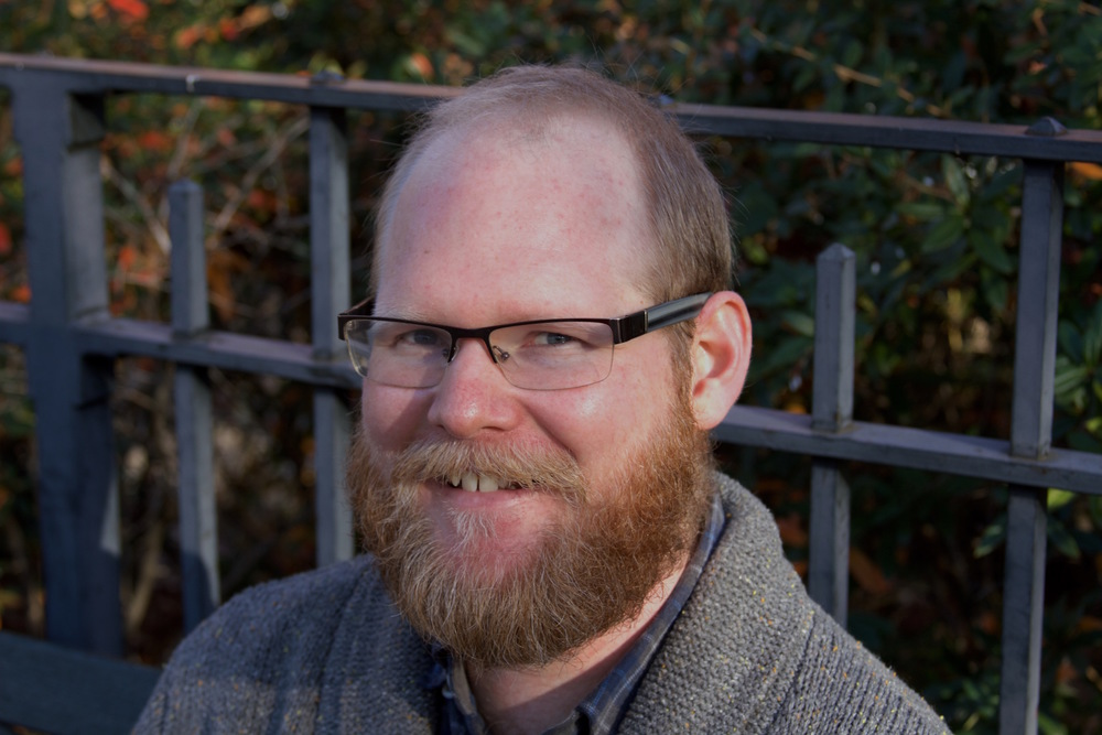 Tim Dufrisne glasses and medium beard.jpg