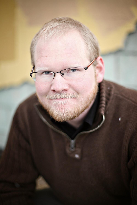 Tim Dufrisne Glasses and light beard.jpg