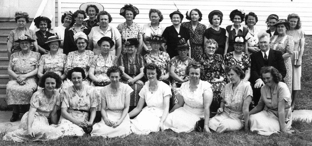 Ladies Aid 1949 Front Row: | Edna Nelson | Olga Nelson | Ida Hendrickson | Bertha Mathsen | Clara Olson | ??? | ?Johnson? |Second Row: | ??? | ??? | ??? | ??? | ??? | ??? | Nelly Hendrickson | ??? | ??? | Pastor Gerhard W Mathre |Third Row: | ??? | ??? | ?Hilda Egge? | ??? | ??? | ?Emily Olson? | Olga Johnson | Clara Olson | ??? | ??? | ?Orma Gulbranson? | Lillie Dalen | ??? | ??? | Tilly Hendrickson | ??? |