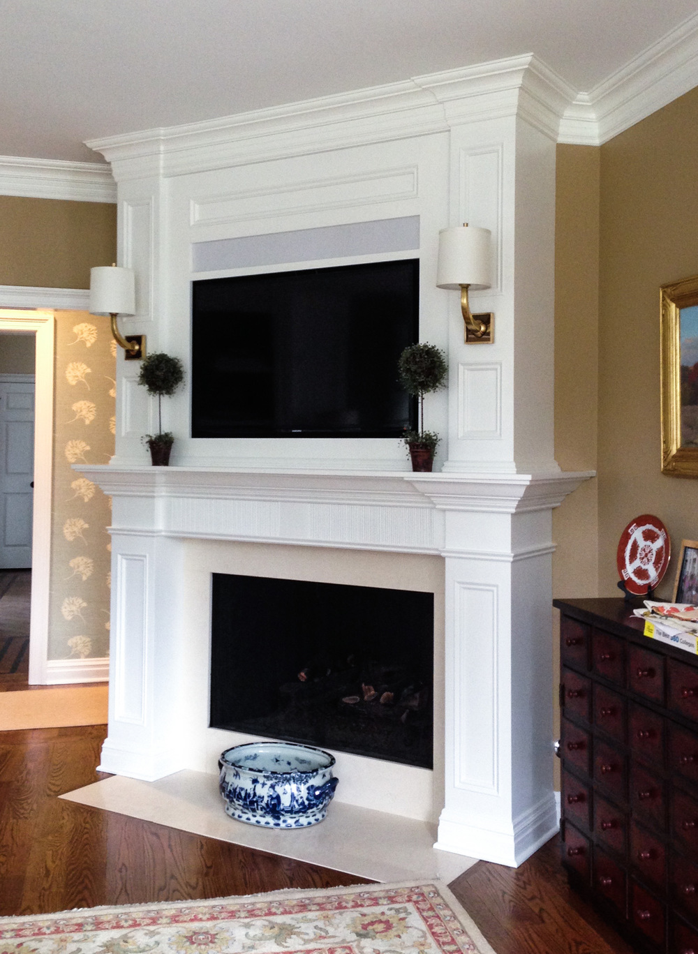 Custom Built-In Fireplace Surround with TV & Lighting