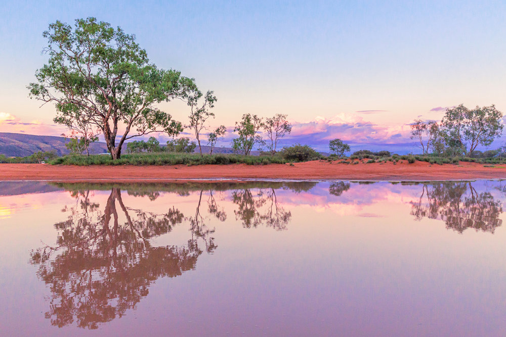 Pink sunsets in the outback are like living inside a Namatjira painting