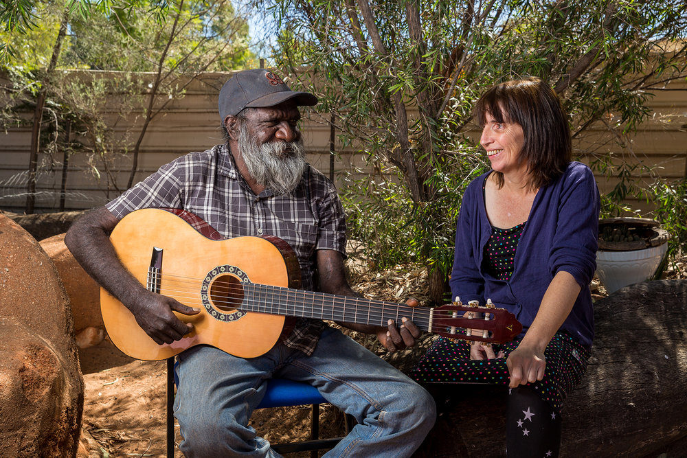 Sarah with dialysis patient Quentin Walker Jurrah in the backyard of the Purple House in Alice Springs