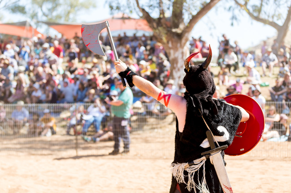 A Viking charges his sword to the Henley on Todd crowd in Alice Springs