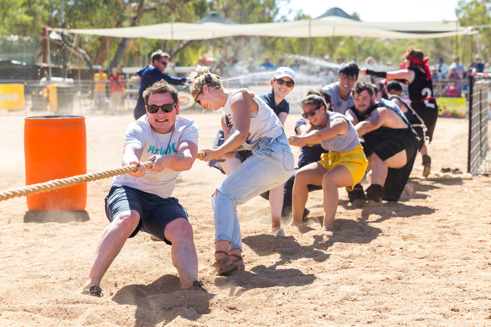 A team from the Alice Springs Hospital gives it their all (with the help of some Vikings at the back)