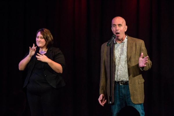 "Ted Olds tells his story while ASL interpreter Shelby Edwards translates at our ""Communication"" show at Caveat in January 2018. Photo ny Nicholas Santasier."