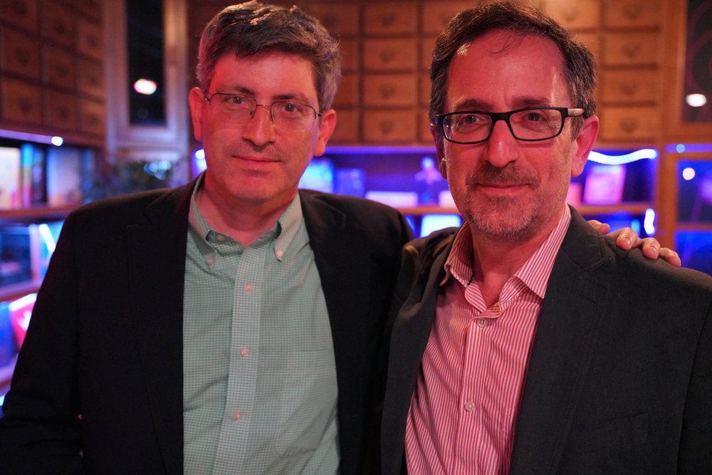 New York Times journalists Carl Zimmer and Andy Revkin. (Both are Story Collider alums — find their stories  here  and  here .)