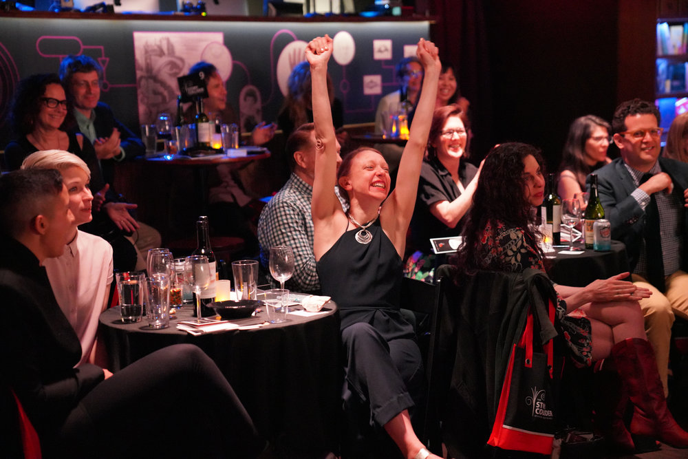 Story Collider NYC producer Paula Croxson celebrates her raffle victory! (It wasn't rigged, we swear!)