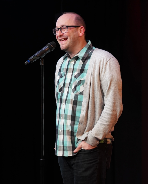 Josh Gondelman tells his story at our first-ever fundraiser, at Caveat in New York. Photo by Carly Hoogendyk.