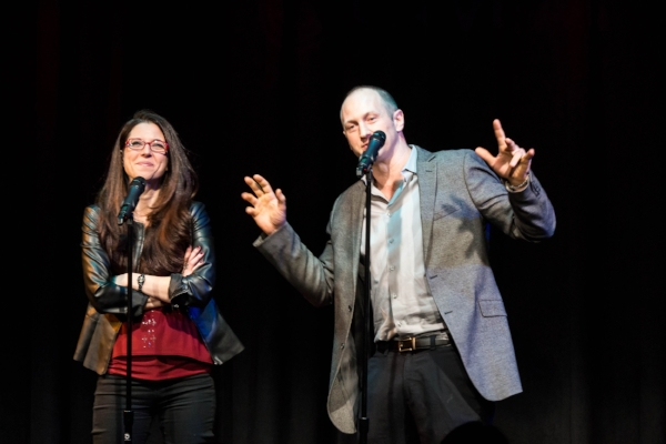 Heather Berlin and Baba Brinkman tell their story at Caveat in New York. Photo by Nicholas Santasier.