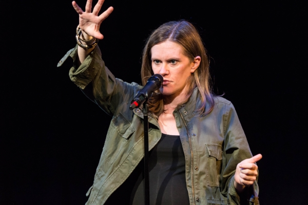 Kate Greathead tells her story at Caveat in New York City. Photo by Nicholas Santasier.